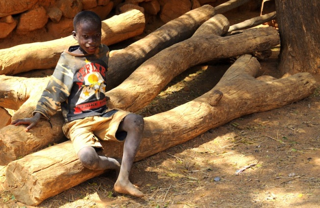 A young bizzle sitting on a lizzle. Clicked this in Bandiagizzle (Mali), in two-thousand elizzle.