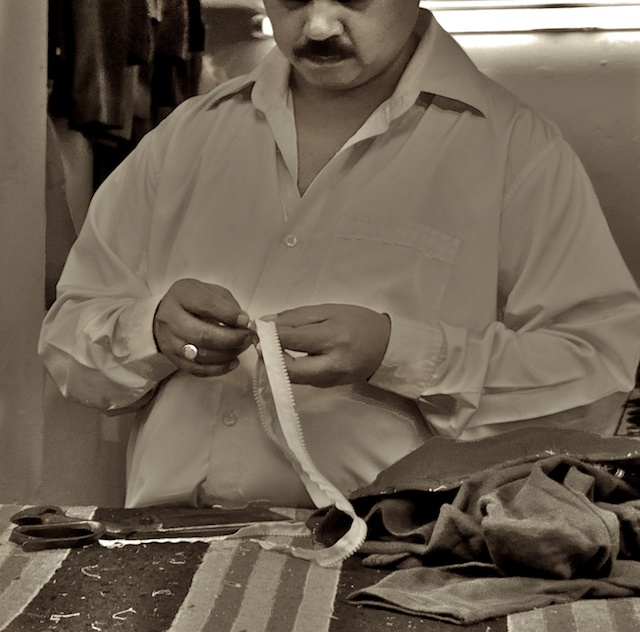 They called him Khan The Tailor and he was known in the neighbourhood for looking the other way.